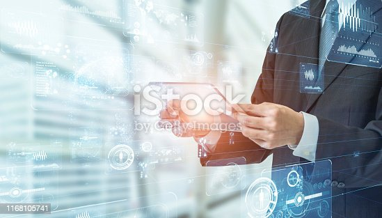 Businessman using transparent portable device. GUI (Graphical User Interface).