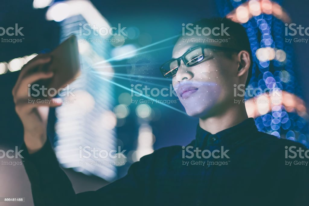 Businessman using using face recognition outdoors - Foto stock royalty-free di Abbigliamento casual