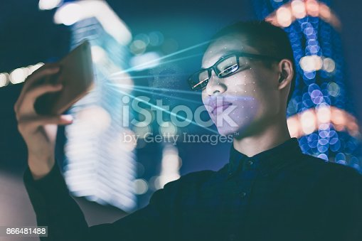 1021681352 istock photo Businessman using using face recognition outdoors 866481488