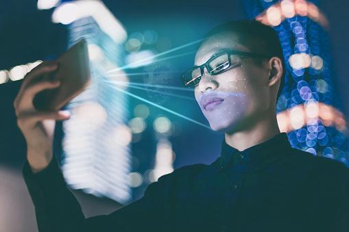 Businessman Using Using Face Recognition Outdoors - Fotografie stock e altre immagini di Abbigliamento casual