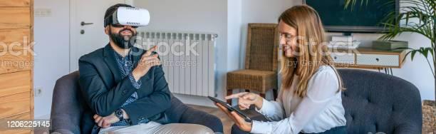 Businessman using virtual reality glasses picture id1206225145?b=1&k=6&m=1206225145&s=612x612&h=dmhanf iqgkjjwsikke9s2dphn9bznwd bxtn9tzjpg=