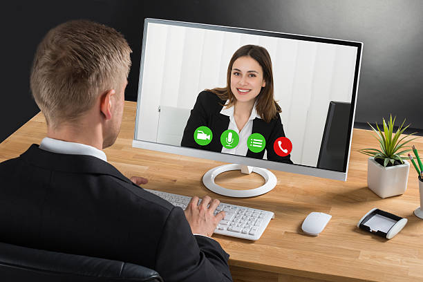 Businessman Video Conferencing On Computer stock photo