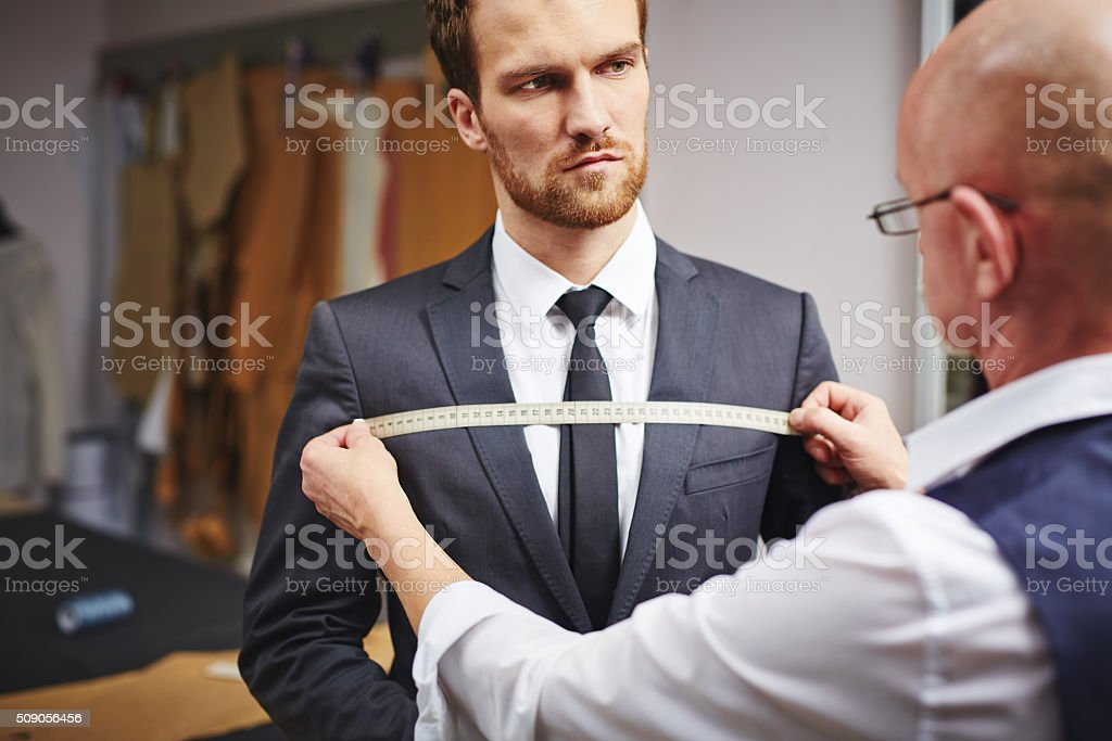 Businessman visiting tailor stock photo