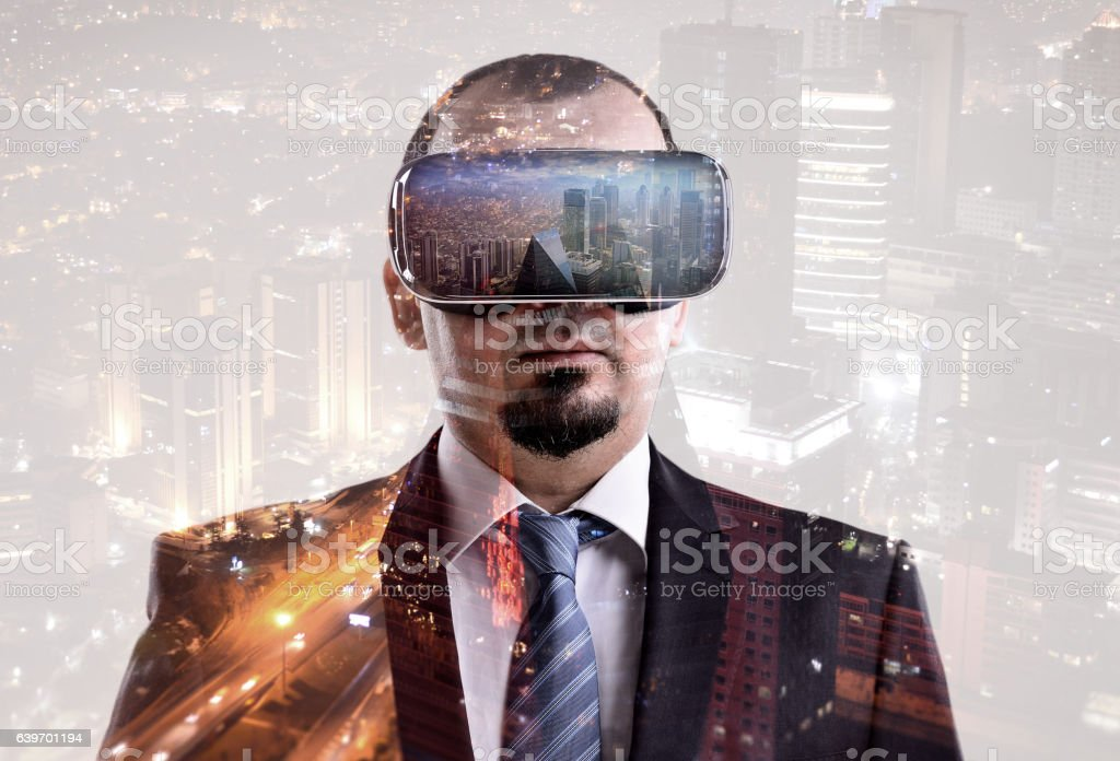 Businessman vr headset double exposure stock photo