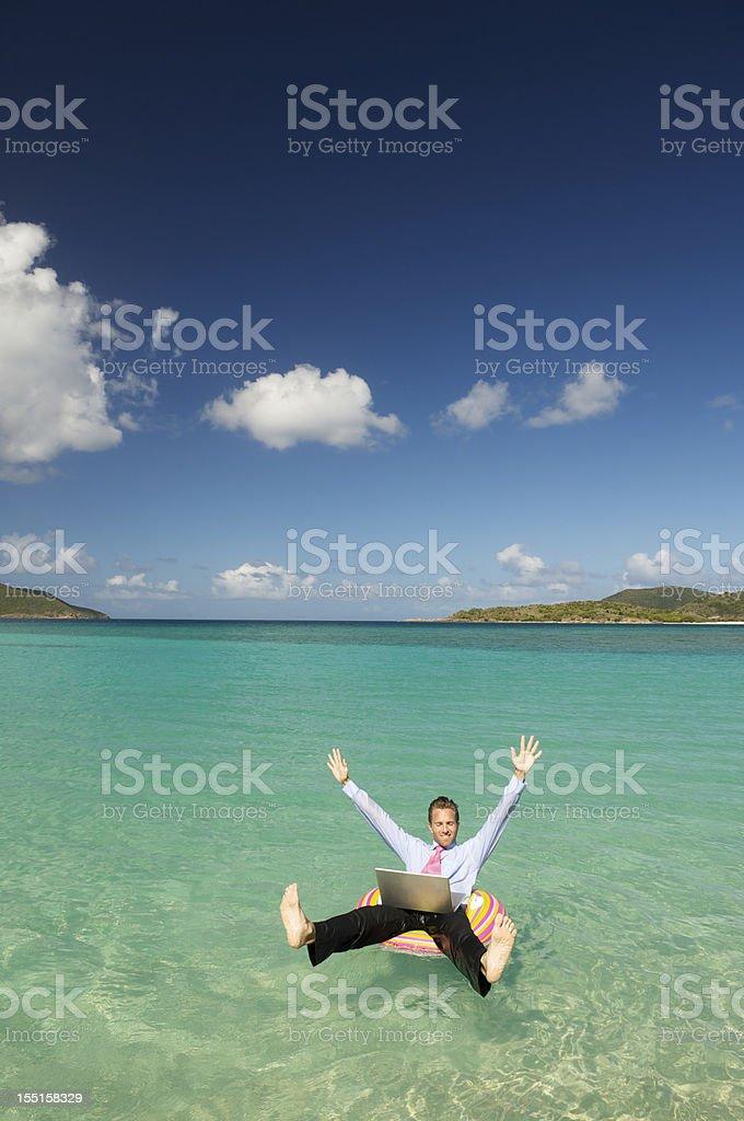 Businessman w Laptop Celebrates from Tropical Bay royalty-free stock photo