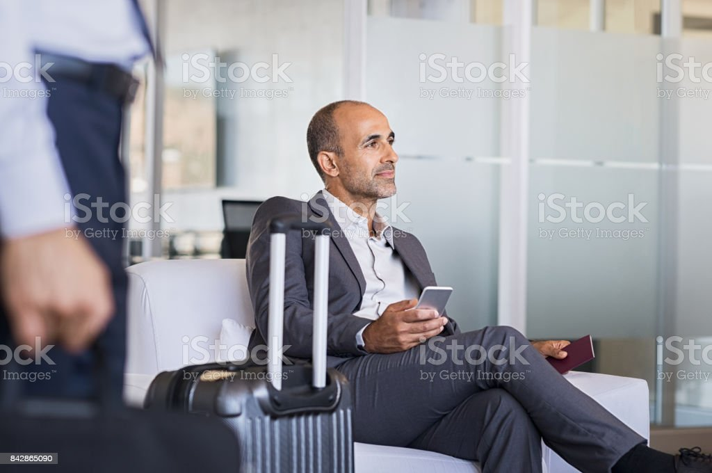 Businessman waiting at airport stock photo