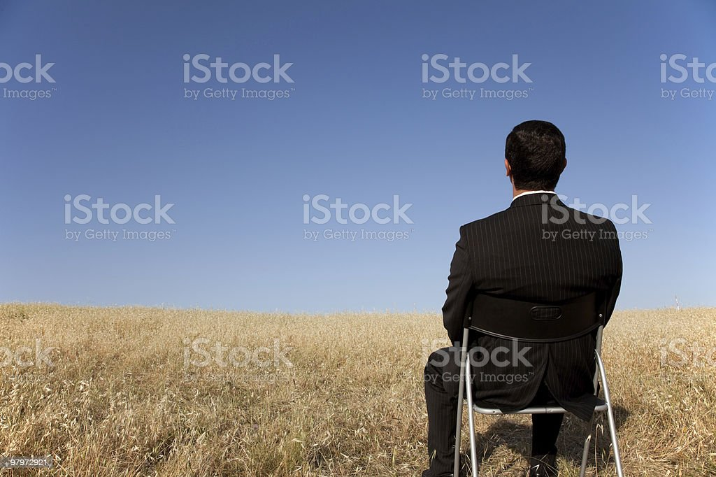 Businessman waiting at the field royalty-free stock photo