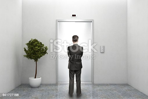 638591126 istock photo Businessman waiting for elevator 941727188
