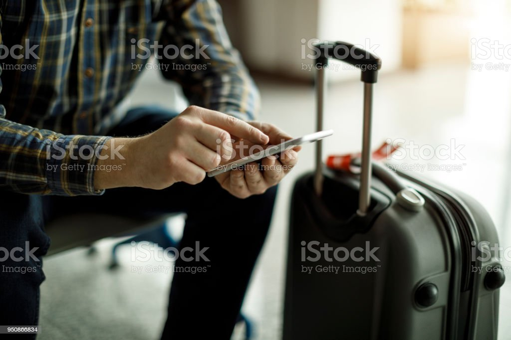 Businessman waiting for his flight at airport stock photo
