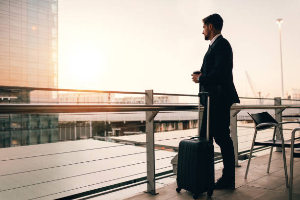 Businessman waiting for his flight in airport lounge stock photo