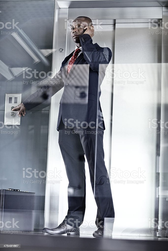 businessman waiting for the elevator stock photo