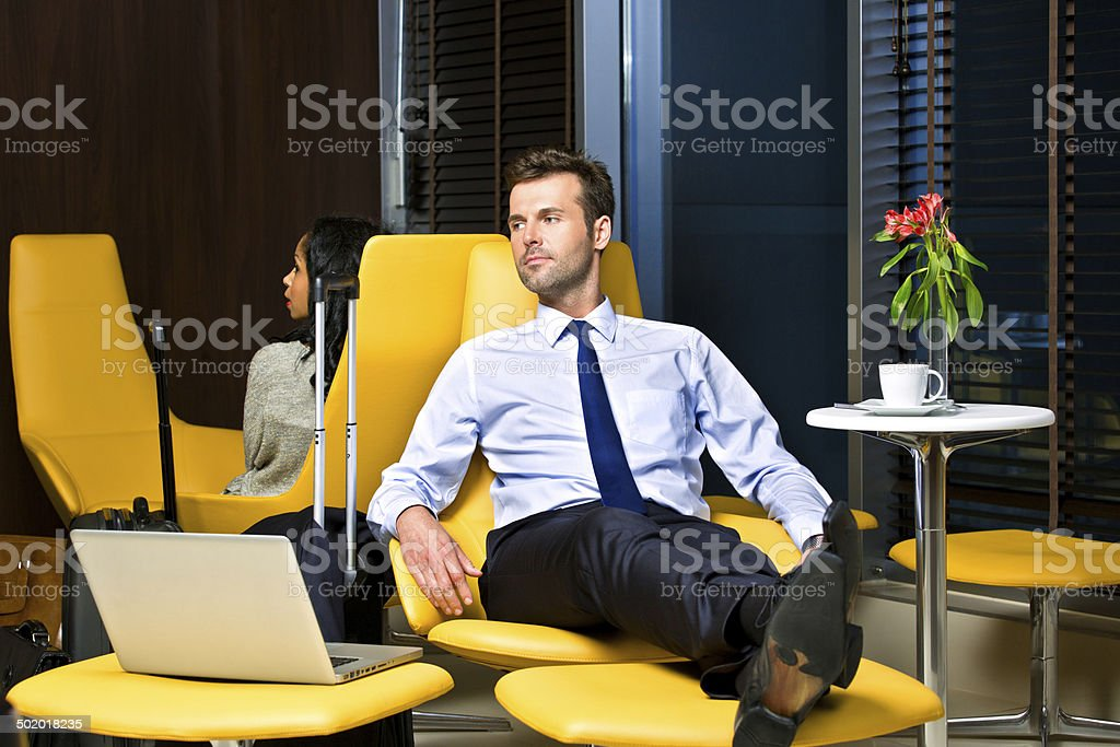 Businessman waiting for the flight stock photo