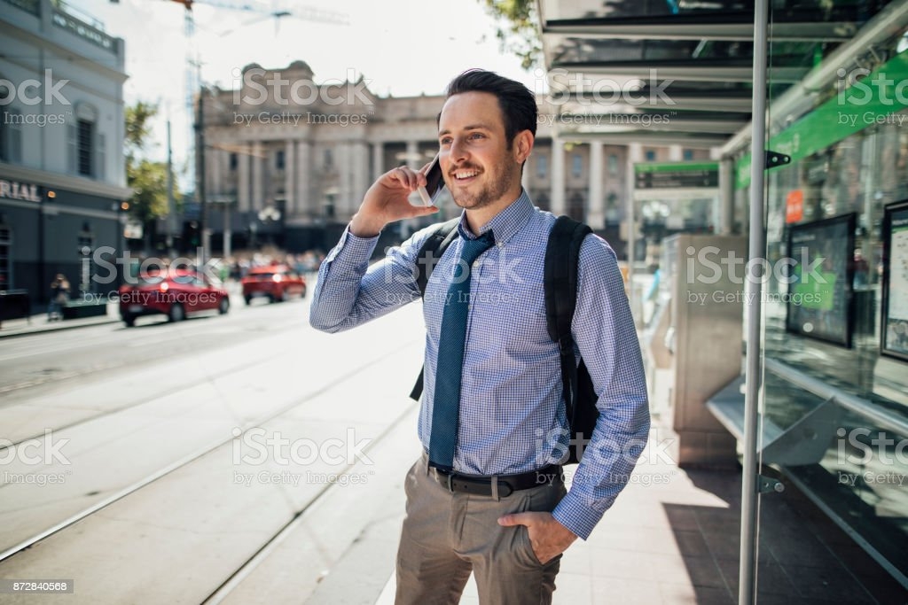 Businessman Waiting For Tram stock photo