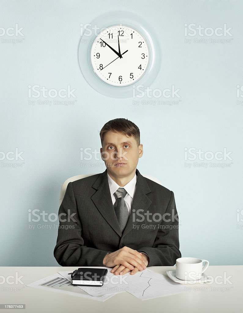 Businessman waiting in an office at the workplace royalty-free stock photo
