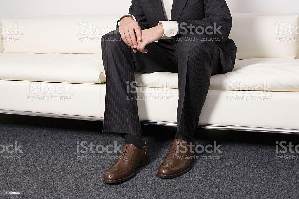 Businessman waiting on a sofa royalty-free stock photo