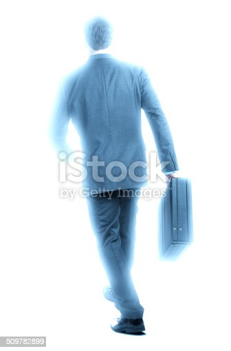 A high key photo of a businessman carrying a briefcase.