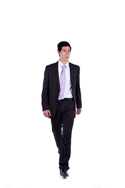 Businessman walking and looking away stock photo