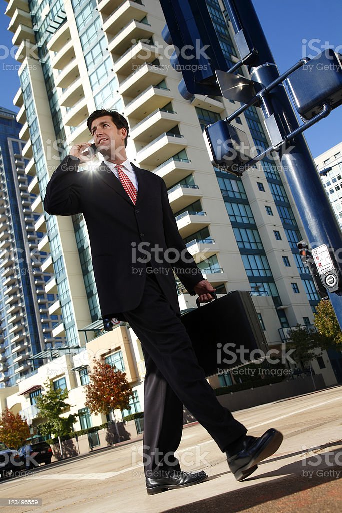 businessman walking and talking on cellphone royalty-free stock photo
