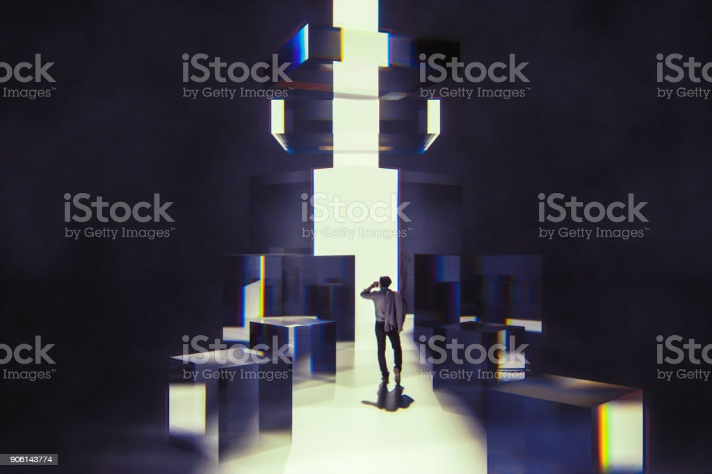 Businessman walking between abstract glass cubes stock photo