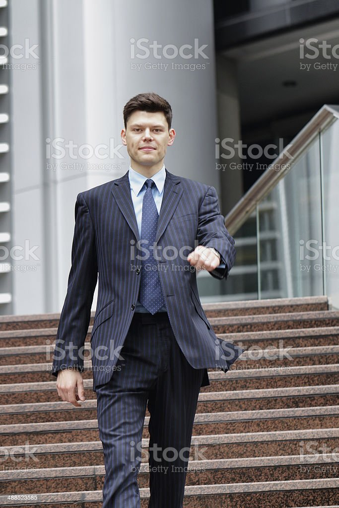 Businessman walking down stairs royalty-free stock photo