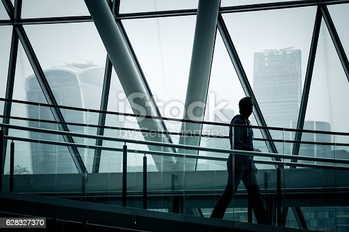 istock Businessman walking down stairs with London skyline in background 628327370