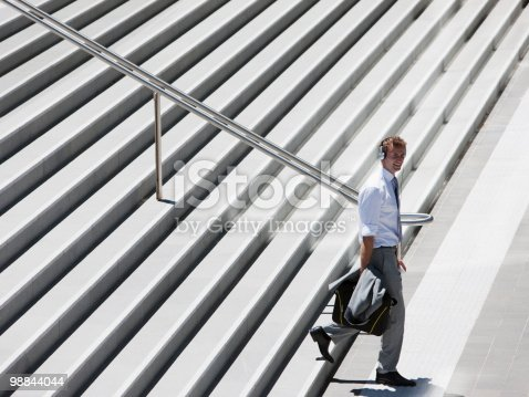 Businessman Walking Down Steps Outdoors Stock Photo & More Pictures of 25-29 Years