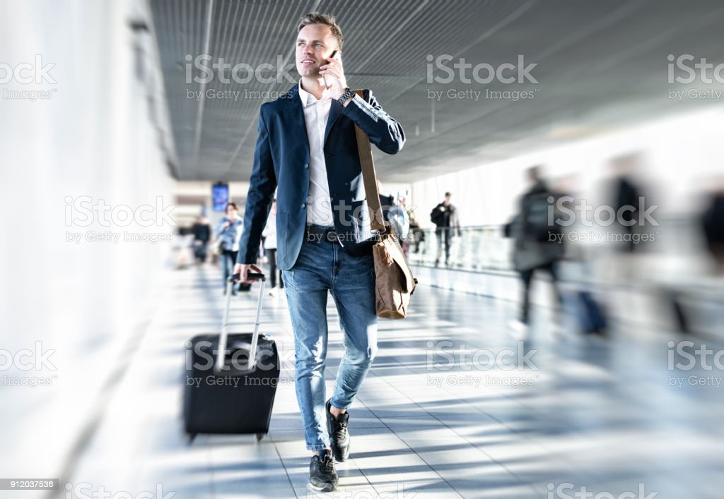 Businessman walking in airport royalty-free stock photo