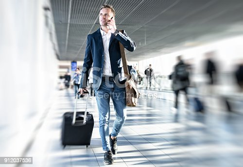 istock Businessman walking in airport 912037536