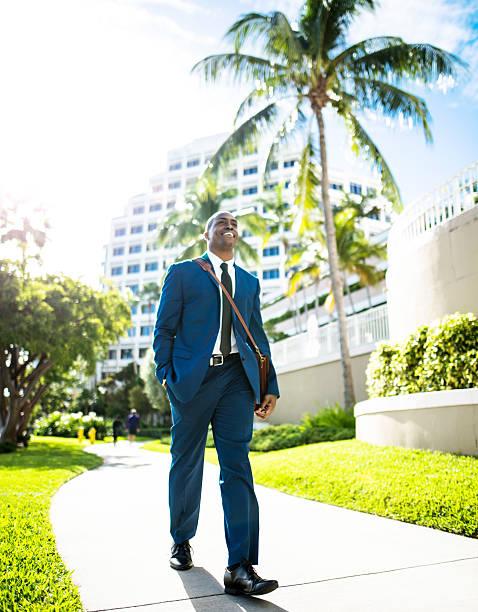 businessman walking in brickell Miami stock photo