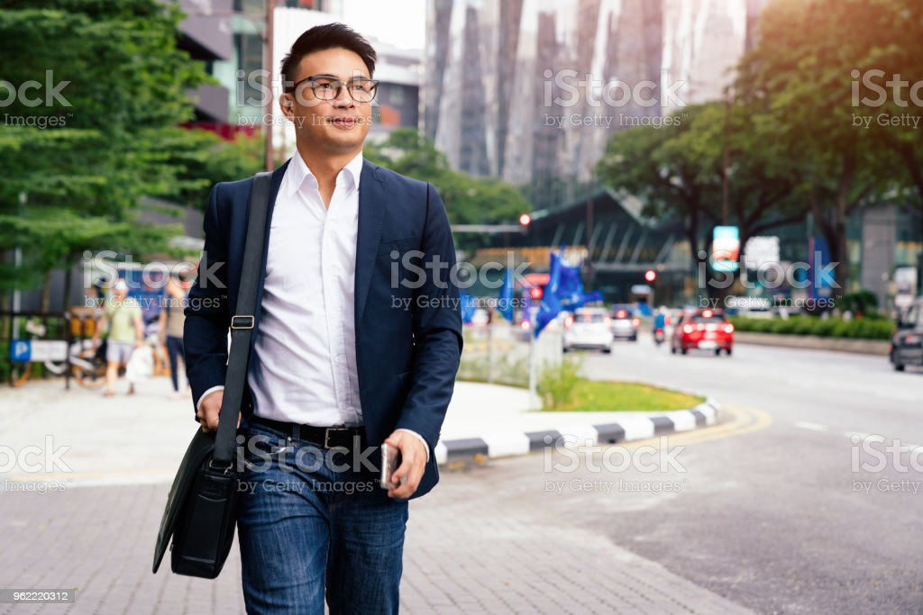 Businessman walking in Downtown Kuala Lumpur Malaysia