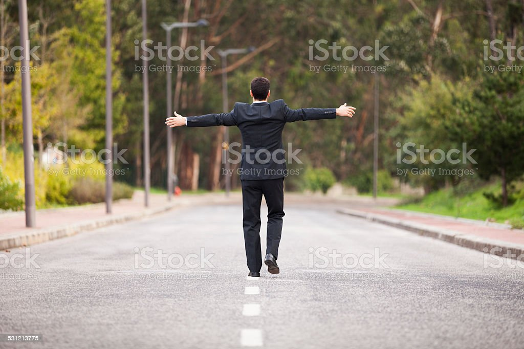 Businessman walking in the road line stock photo