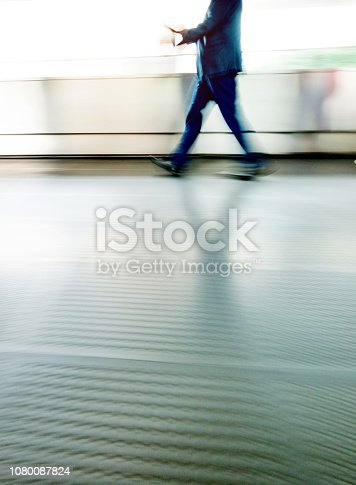 171150458 istock photo Businessman walking on city footbridge 1080087824