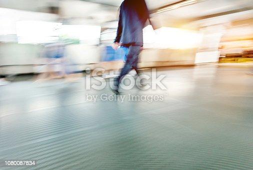 171150458 istock photo Businessman walking on city footbridge 1080087834