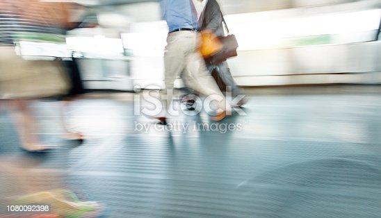 171150458 istock photo Businessman walking on city footbridge 1080092398