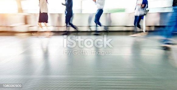 171150458 istock photo Businessman walking on city footbridge 1080092920