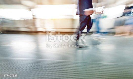 171150458 istock photo Businessman walking on city footbridge 1177407937