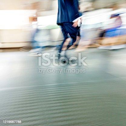 171150458 istock photo Businessman walking on city footbridge 1219687788