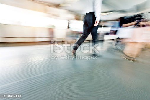 171150458 istock photo Businessman walking on city footbridge 1219689140