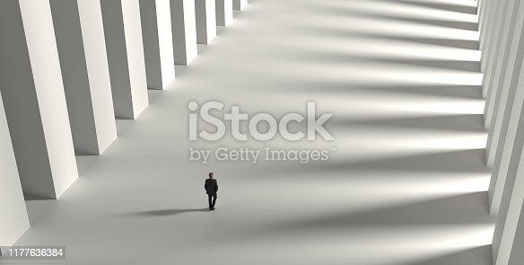 Businessman walking on corridor