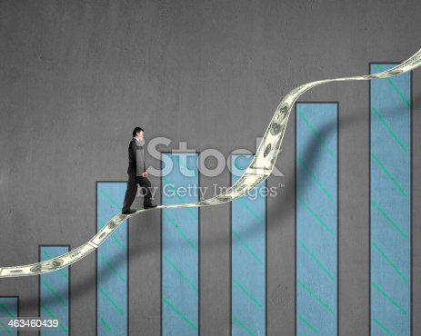 istock Businessman walking on growth money trend with chart 463460439