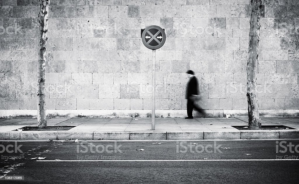 Businessman walking on the street royalty-free stock photo