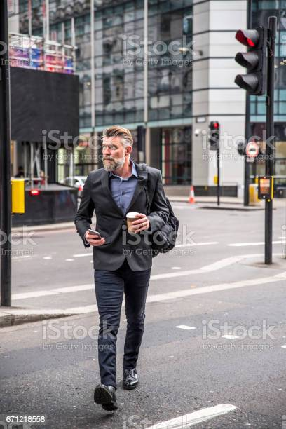 Businessman walking on the street picture id671218558?b=1&k=6&m=671218558&s=612x612&h=jhngn6ad9fgj94tlyfmpef8f0livahwle1dgkgv1cro=
