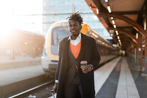 Businessman walking on the train station platform