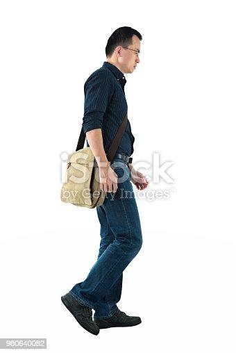 istock Businessman walking on white background 980640082