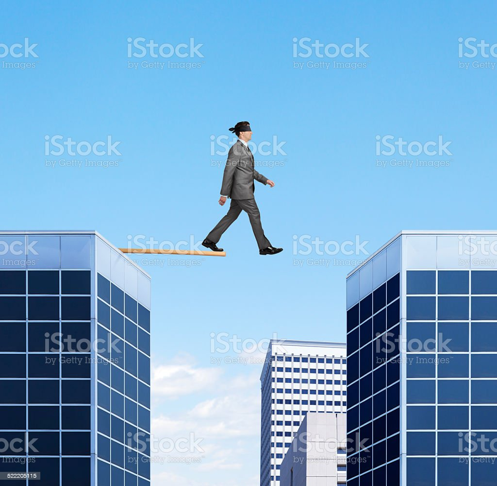 Businessman Walking the Plank Off High Rise Building stock photo