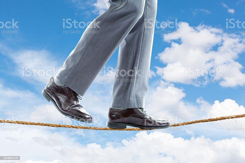 Businessman Walking the tightrope Close-up stock photo