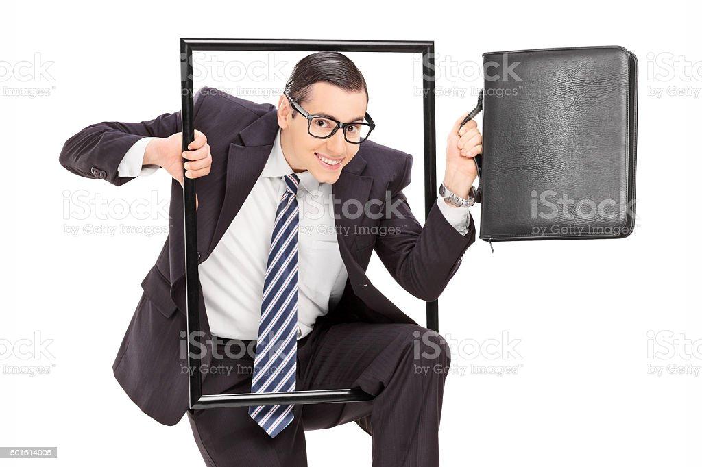 Businessman walking through a frame stock photo