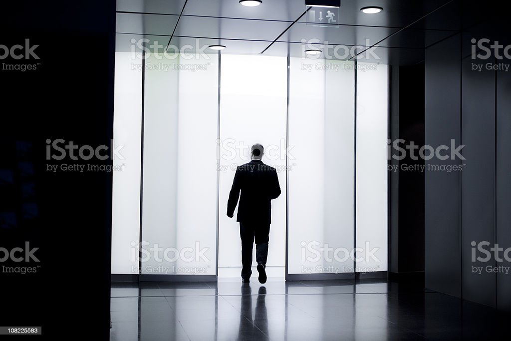 Businessman Walking Through Glass Doors Stock Photo More Pictures