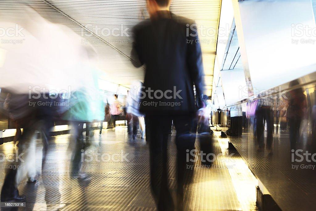 Businessman Walking Through Pedestrian Walkway royalty-free stock photo