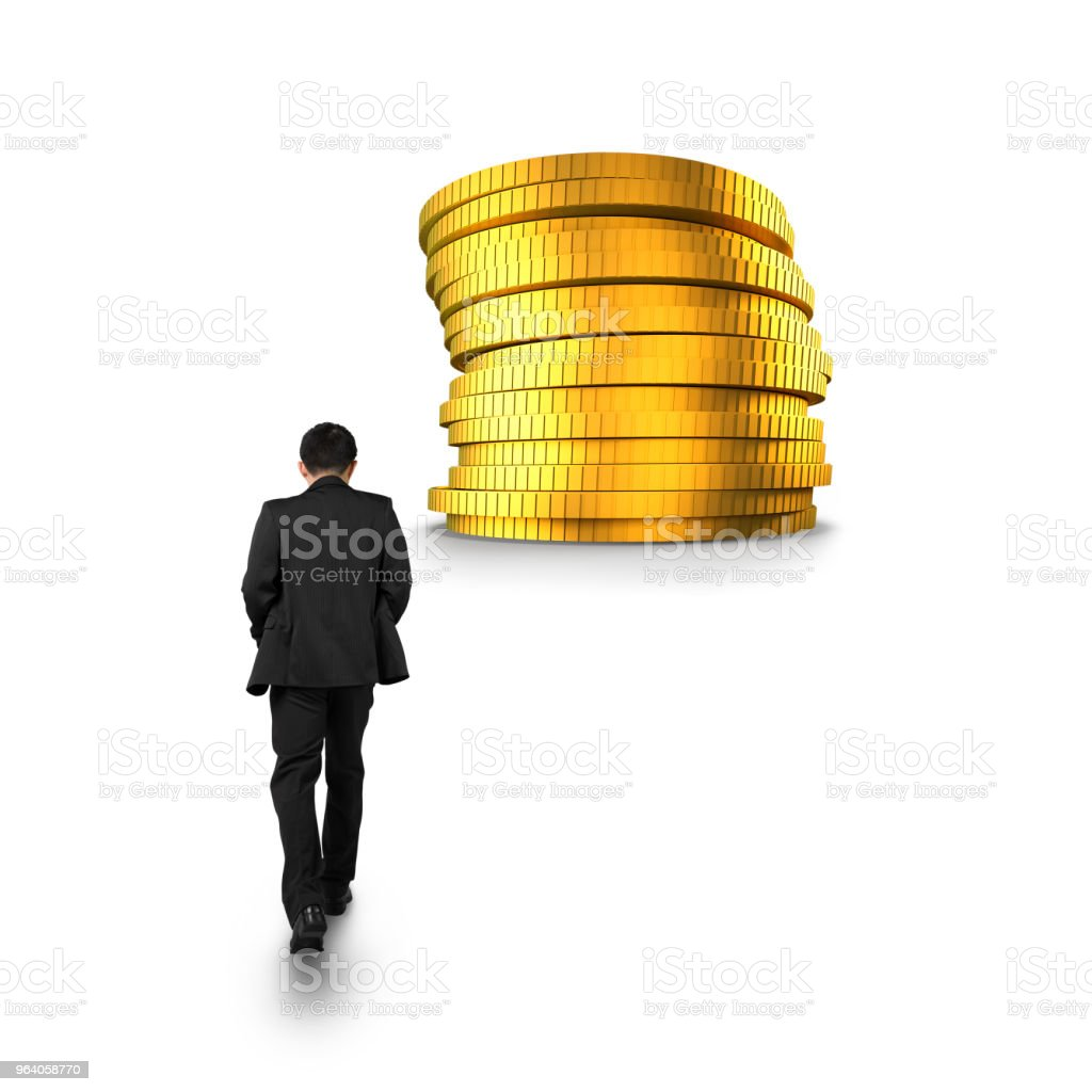Businessman walking toward stack of golden coins - Royalty-free Achievement Stock Photo